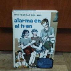 Libros de segunda mano: ALARMA EN EL TREN MONTSERRAT DEL AMO EDITORIAL JUVENTUD 1971. Lote 189342046