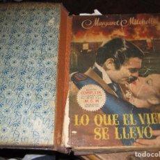 Libros de segunda mano: LO QUE EL VIENTO SE LLEVO . ED COMPLETA ILUSTRADA CON FOTOS DE LA PELICULA . 4 ED 1949. Lote 93299315