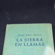 Libros de segunda mano: LA SIERRA EN LLAMAS DE ÁNGEL RUIZ AYUCAR. Lote 149610702