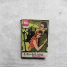 Libros de segunda mano: ENTRE DOS LUCES POR CORIN TELLADO MINI LIBROS BRUGUERA Nº 75. Lote 188507113