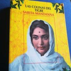 Libros de segunda mano: LAS COLINAS DEL TIGRE MANDANNA SARITA SALAMANDRA PRIMERA EDICIÓN. Lote 195477561