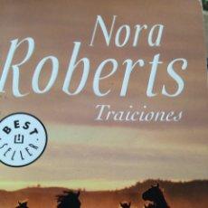Libros de segunda mano: NORA ROBERTS TRAICIONES. Lote 210604670