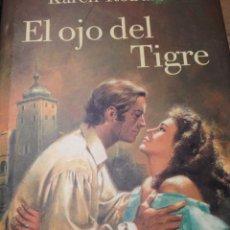 Libros de segunda mano: KAREN ROBARDS EL OJO DEL TIGRE. Lote 210609157
