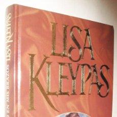 Libros de segunda mano: UN EXTRAÑO EN MIS BRAZOS - LISA KLEYPAS. Lote 210736325