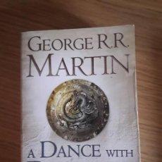 Libros de segunda mano: A DANCE WITH DRAGONS 1. DREAMS AND DUST GEORGE MARTIN. Lote 155667678