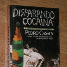 Libros de segunda mano: DISPARANDO COCAÍNA POR PEDRO CASALS DE ED. PLAZA JANÉS EN BARCELONA 1986 PRIMERA EDICIÓN. Lote 30315749