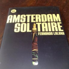 Libros de segunda mano: AMSTERDAM SOLITAIRE - FERNANDO LALANA (TAPA DURA CON SOBRECUBIERTA CALADA, CINTA DE LECTURA) NUEVO. Lote 99678820