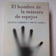Libros de segunda mano: EL HOMBRE DE LA MÁSCARA DE ESPEJOS. GARRIDO VICENTE Y ABARCA NIEVES. 2015. Lote 194668935