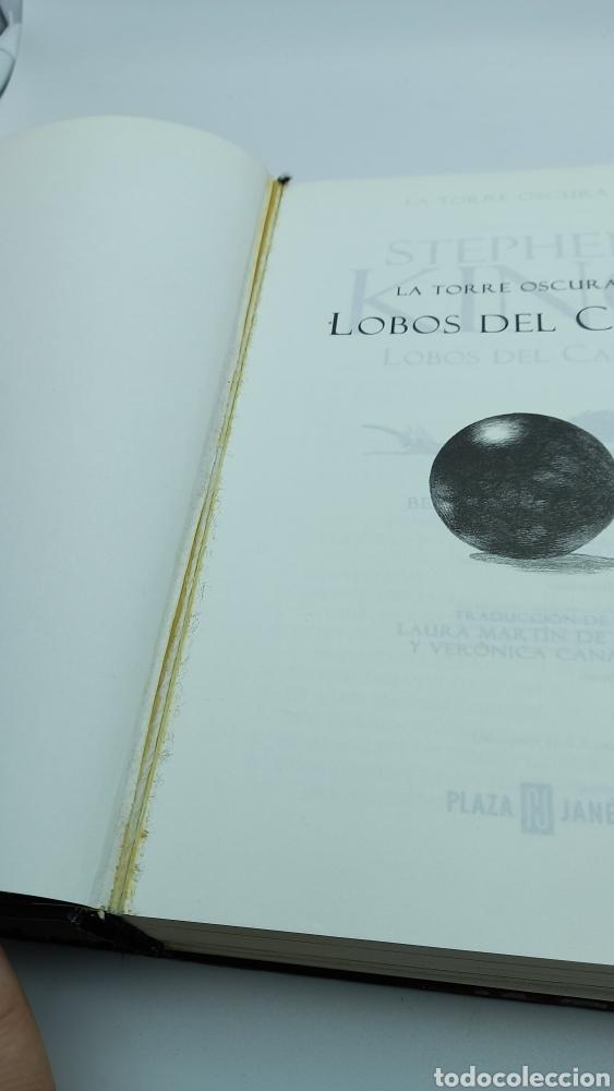 Libros de segunda mano: LIBRO STEPHEN KING - LA TORRE OSCURA V LOBOS DEL CALLA - PLAZA JANÉS - PRIMERA EDICIÓN 2004 - Foto 2 - 221488511