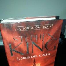 Libros de segunda mano: STEPHEN KING LA TORRE OSCURA V: LOBOS DEL CALLA. Lote 245654560