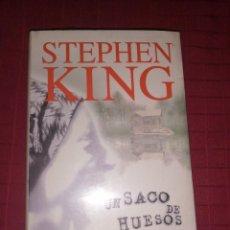 Libros de segunda mano: STEPHEN KING , UN SACO DE HUESOS. Lote 253354700