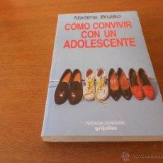 Libros de segunda mano: PSICOLOGÍA: COMO CONVIVIR CON UN ADOLESCENTE (BRUSKO, M.) ED. GRIJALBO . Lote 45078566