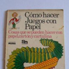 Libros de segunda mano: LIBRO COMO HACER JUEGOS CON PAPEL EDICIONES PLESA SM. Lote 50946868