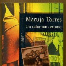 Libros de segunda mano: UN CALOR TAN CERCANO - MARUJA TORRES. Lote 115413611