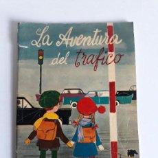 Libros de segunda mano: LA AVENTURA DEL TRAFICO.JEFATURA CENTRAL DE TRAFICO .1962. Lote 128048411