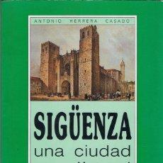 Libros de segunda mano: SIGÜENZA, UNA CIUDAD MEDIEVAL - ANTONIO HERRERA CASADO. Lote 132156810