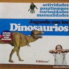 Libros de segunda mano: JUGANDO CON LOS DINOSAURIOS. PÚBLICO. Lote 146551706