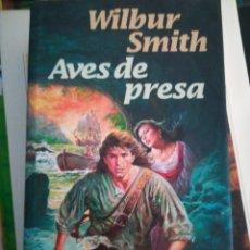 Libros de segunda mano: WILBUR SMITH AVES DE PRESA. Lote 150107380