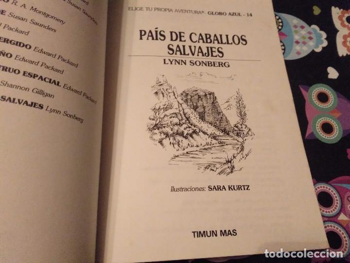 Libros de segunda mano: DIFICIL LIBRO ELIGE TU PROPIA AVENTURA TIMUN MAS Nº 14 PAIS DE CABALLOS SALVAJES LYNN SONBERG 1986 - Foto 2 - 152213510