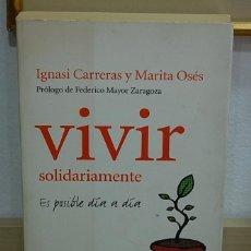 Libros de segunda mano: LMV - VIVIR SOLIDARIAMENTE, ES POSIBLE DÍA A DÍA. Lote 156881654