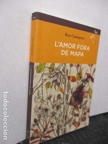 Libros de segunda mano: L'amor fora de mapa (SEMBRA LLIBRES) - Roc Casagran - Foto 2 - 160484470