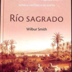 Libros de segunda mano: RÍO SAGRADO - WILBUR SMITH. Lote 171529542