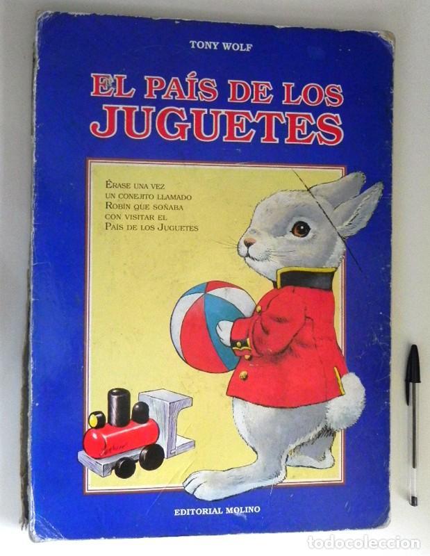 Libros de segunda mano: EL PAÍS DE LOS JUGUETES LIBRO INFANTIL - TONY WOLF - GRAN TAMAÑO - PRECIOSAS ILUSTRACIONES - MOLINO - Foto 2 - 207104565