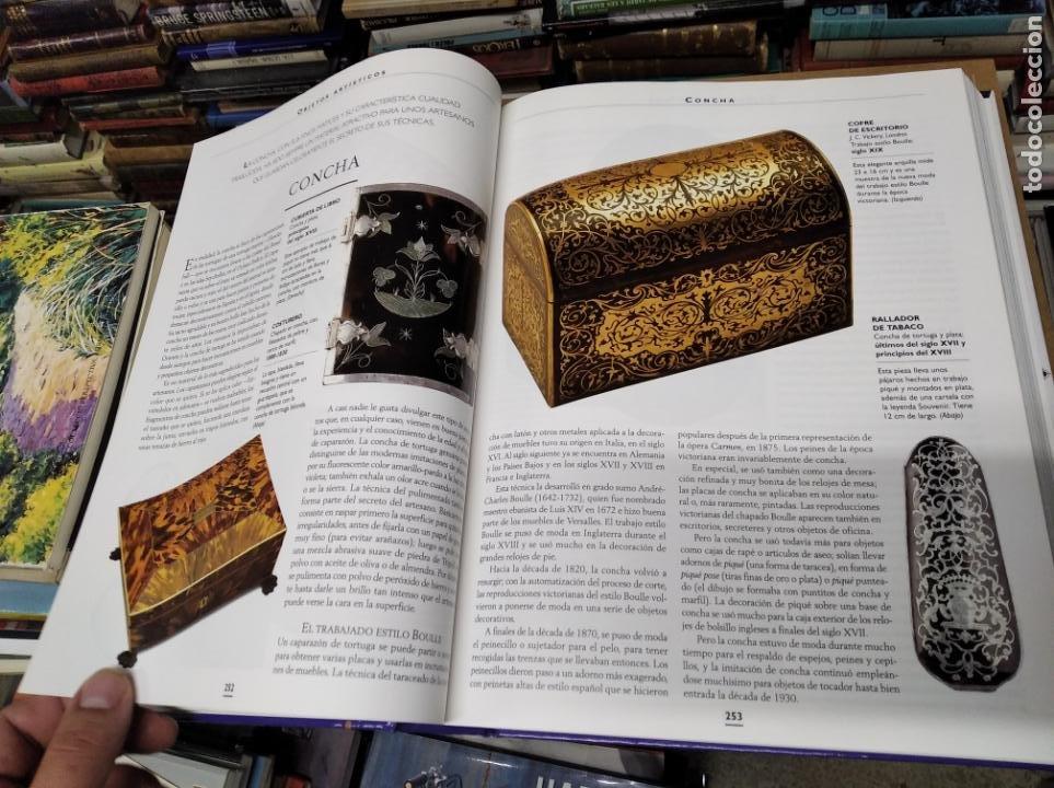 Libros de segunda mano: HISTORIA ILUSTRADA DE LAS ANTIGÜEDADES. HUON MALLALIEU . ED. LIBSA. 2000. RELOJES, JUGUETES, ARMAS - Foto 29 - 210702695