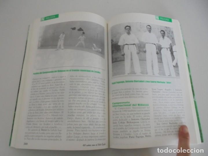Libros de segunda mano: 60 AÑOS CON EL BETI GAZTE. 1940-2000. AYUNTAMIENTO DE LESAKA. 2000. - Foto 12 - 245217140