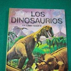 Libros de segunda mano: LOS DINOSAURIOS. UN LIBRO MAGICO. CON ILUSTRACIONES SORPRESA. MONTENA. Lote 286443453