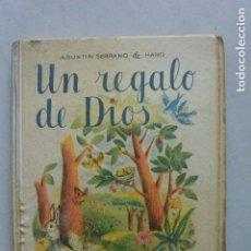 Libros de segunda mano: LIBRO UN FREGALO DE DIOS. 17 ED. EDCUELA ESPAÑOLA 1956. Lote 125640219