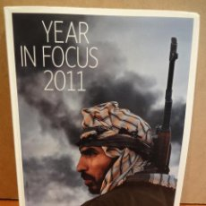 Libros: YEAR IN FOCUS 2011. 157 PÁGINAS CON LAS MEJORES FOTOGRAFÍAS DEL AÑO. COMO NUEVO.. Lote 44655334