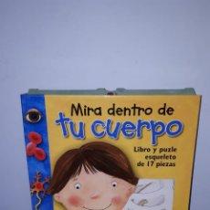 Libros: MIRA DENTRO DE TU CUERPO. EL CUERPO HUMANO. ESQUELETO.. Lote 143157149