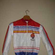 Coleccionismo deportivo: CAZADORA CORTAVIENTOS DEL MUNDIAL ESPAÑA 82. NARANJITO. TALLA 14.. Lote 32372375