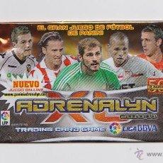 Coleccionismo deportivo: SOBRE VACIO (NO CONTIEN CROMOS) - COLECCION ADRENALYN 2010 2011 PANINI - VERSION CASILLAS . Lote 48562012