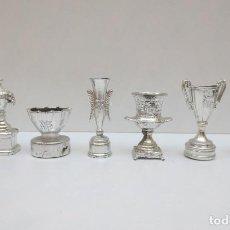 Coleccionismo deportivo: 7 COPAS METÁLICAS EN MINIATURA DEL BARÇA / BARCELONA. Lote 185730055