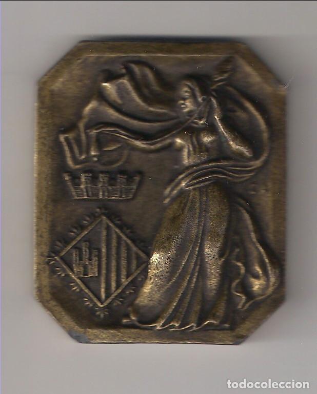 MEDALLA D'OR DE LA CIUTAT DE TERRASSA VOLUNTARIS 92. ENTREGADA EL 29-10-92. BRONCE. (MD15) (Numismática - Medallería - Condecoraciones)