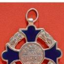 Medallas condecorativas: ANTIGUA MEDALLA AL MERITO ESCOLAR EN LATÓN Y ESMALTE. Lote 53087143