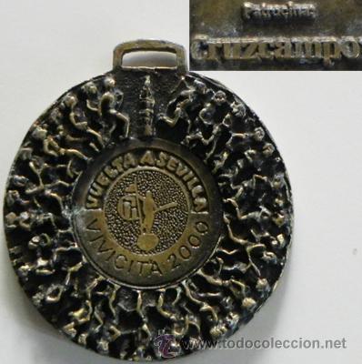 MEDALLA - VIVICITA 2000 VUELTA A SEVILLA - PATROCINA CERVEZA CRUZCAMPO - DEPORTE CARRERA - DE METAL (Coleccionismo Deportivo - Medallas, Monedas y Trofeos - Otros deportes)