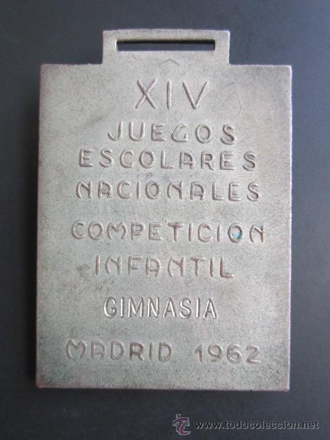 Coleccionismo deportivo: MEDALLA JEN. XIV JUEGOS ESCOLARES NACIONALES. COMPETICIÓN INFANTIL. GIMNASIA. MADRID, 1962. 35X50MM - Foto 2 - 48569671