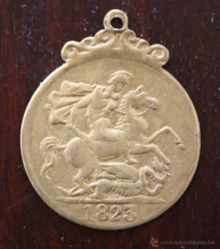 ANTIGUA MONEDA TRANSFORMADA EN MEDALLA GEORGIUS III D: G: BRITANNIA REX – 1823 (Numismática - Medallería - Histórica)