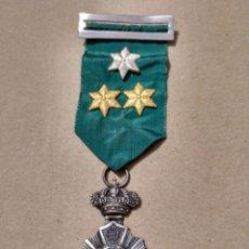 Medallas históricas: BONITA MEDALLA ESCOLAR AL MÉRITO TRES ESTRELLAS. Lote 140716846