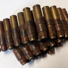 Militaria: CINTA METALICA CON 23 VAINAS DE CETME, INERTES. Lote 60252823