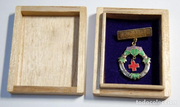 MEDALLA DE PLATA DE LA CRUZ ROJA DE JAPON.AL MERITO DE LAS ENFERMERAS DE 2ª CLASE.2ª GUERRA MUNDIAL (Militar - II Guerra Mundial)