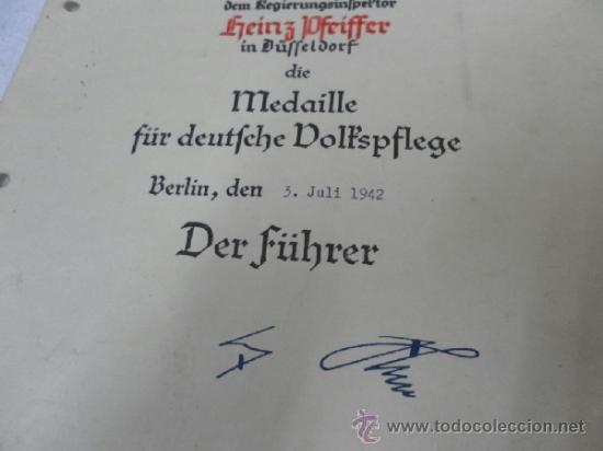Militaria: Alemania. Medalla del Bienestar Social. Con diploma de concesión. II Guerra Mundial. - Foto 4 - 36480909