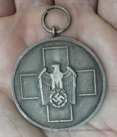Militaria: Alemania. Medalla del Bienestar Social. Con diploma de concesión. II Guerra Mundial. - Foto 6 - 36480909