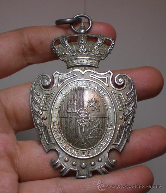 MEDALLA MAGISTERIO PRIMERA ENSEÑANZA - ALFONSO XIII - MINISTERIO DE FOMENTO - PLATA (Militar - Medallas Españolas Originales )
