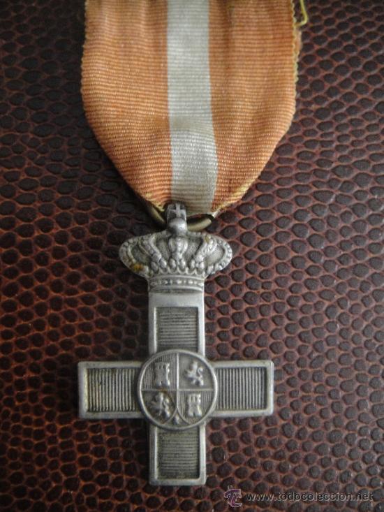 CRUZ DE PLATA AL MÉRITO MILITAR . GOBIERNO PROVISIONAL 1868-1870 CINTA MUY ANTIGUA (Militar - Medallas Españolas Originales )
