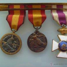 Militaria: GUERRA CIVIL : PASADOR DE UN VETERANO COMBATIENTE NACIONAL , DE CUATRO CON TRES MEDALLAS. Lote 48205517