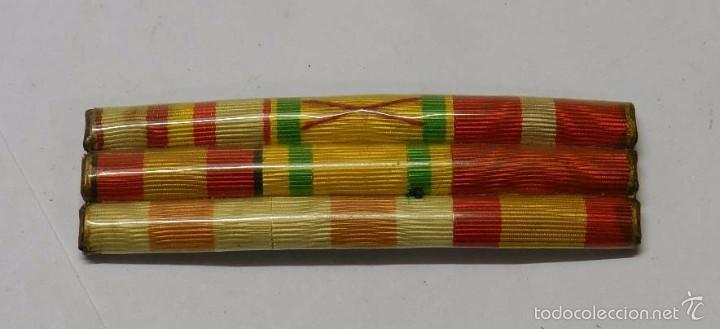 PASADOR DE CONDECORACIONES ANTIGUO, CON 9 CINTAS. MIDE 9 CMS. (Militar - Cintas de Medallas y Pasadores)